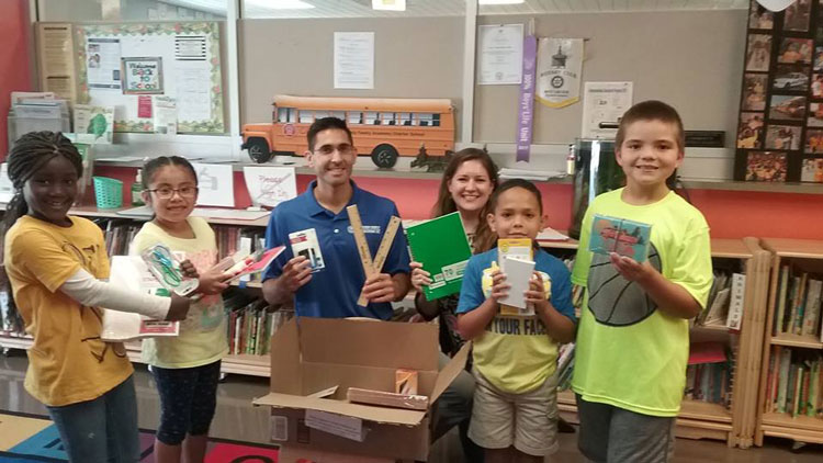 Dr. Raj an d Ally donating books in West Chester, PA